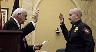 Scott Booth, right, sworn in by Clerk of Circuit Court Gerald Gibson